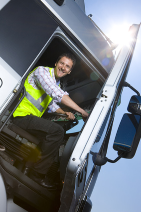 Image showing driver smiling opening door of articulated lorry we call this the  Luck Lorry Driver