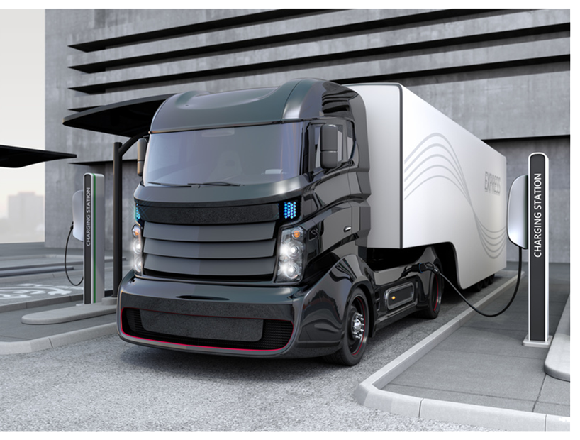 Hybrid-electric-truck-being-charging-at-charging-station-