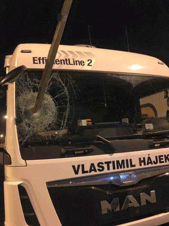 Damage to lorry post through windscreen